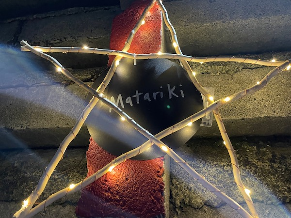 A light-covered star marks Matariki on the steps of Home St Reserve, Arch Hill